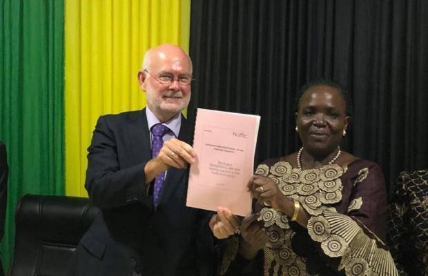 Minister of Education, Science, Technology and Vocational Training, Hon. Prof. J. Ndalichako (MP)  and Ambassador of the Netherlands to Tanzania, Jeroen Verheul holding the project document